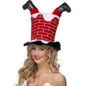 Jultomten sitter fast i skorstenen hatt